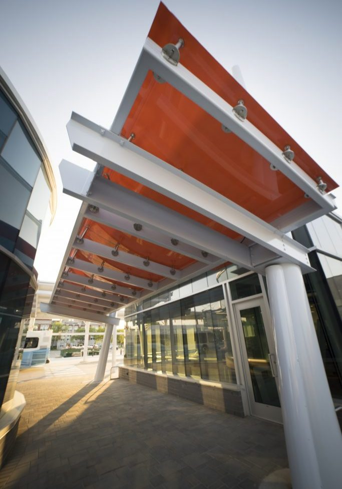 Building with orange painted glass awning